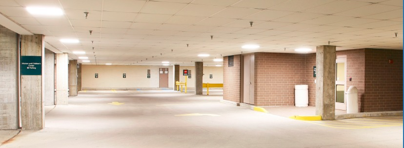 Lumination™ LED Recessed Troffers illuminate the garage entrance and exit ways.